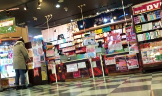 view of the AKB48 merch counter from my seat on the floor